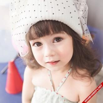 Cô bé mang dòng máu lai đẹp như thiên thần
