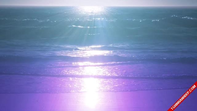 Bãi biển gợn sóng ánh hoàng hôn